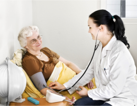 Nurse checking the blood pressure of a senior